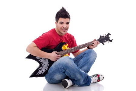 picture of a seated guitarist playing an electric guitar  photo