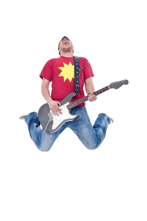 headbanging: Awesome guitar player jumps with passion in studio