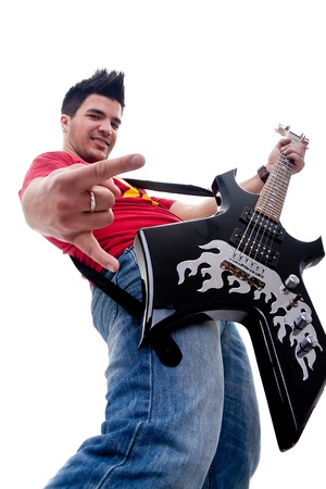 Musician with guitar gesturing rock sign over white - wide angle picture photo