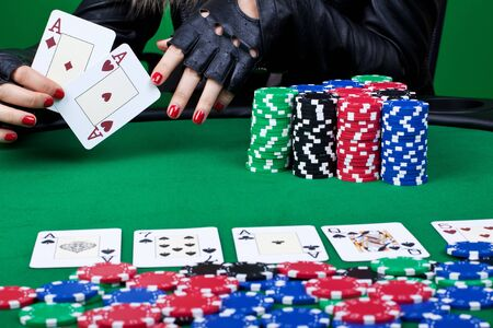 cluseup picture of a winning hand at poker - four aces, two in handm two on the table photo