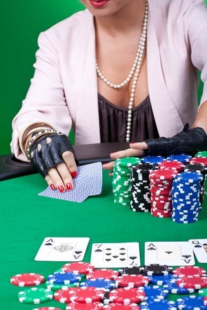 closeup picture of a woman pushing all in at a poker table Stock Photo - 9153735