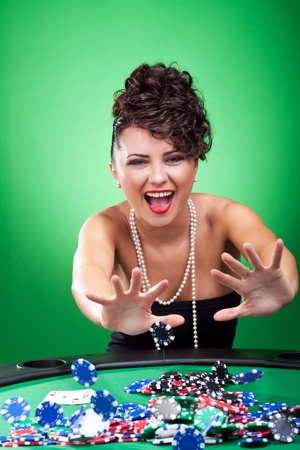 sexy woman at poker table pushing all in Stock Photo - 9153737