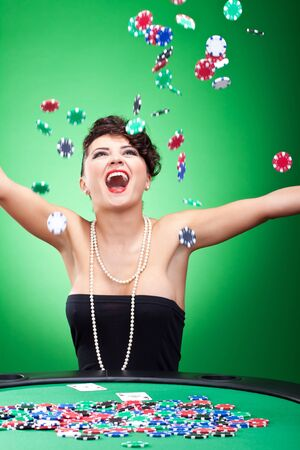 croupier: very happy casion lady winning and throwing chips in the air Stock Photo
