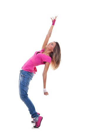 Beautiful woman dancer in hip hop attire striking a pose, isolated photo