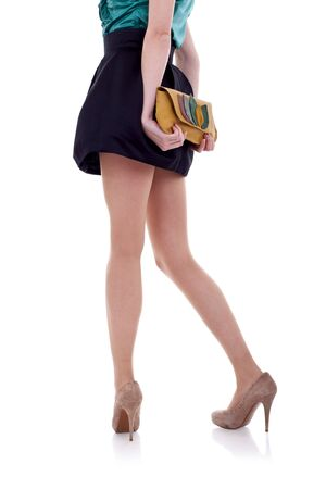 footgear: long legs on high heels and purse over white