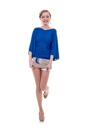 Elegant young woman with purse on white background expressing positivity by laughing photo
