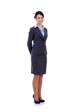 only one woman: young happy smiling business woman, with hands at her back, isolated on white