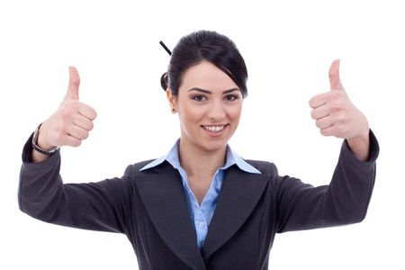 attractive young woman gesturing thumbs up sign with both hands on a white background  photo