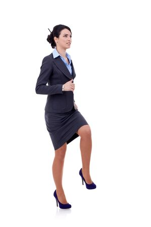 Young attractive business woman stepping on imaginary step  Stock Photo - 9248363