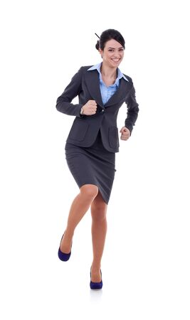 joyous young female business executive celebrating success and dancing on white