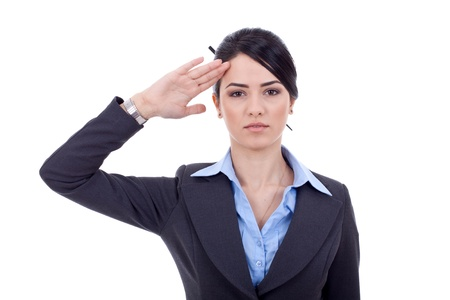 allegiance: Attractive business woman saluting over white background