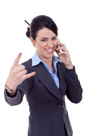Happy business woman with phone making a rock and roll hand gesture photo