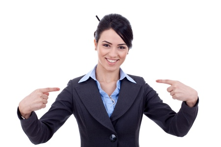 Friendly young business woman pointing at herself - the chosen one