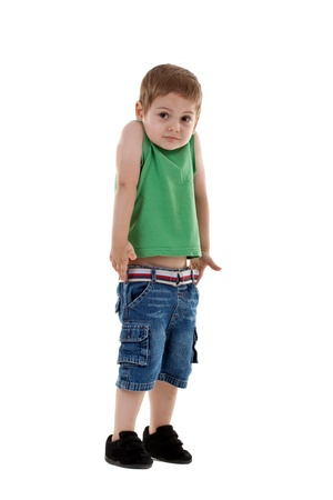 no shirt: confused little boy lifting his shoulders over white Stock Photo