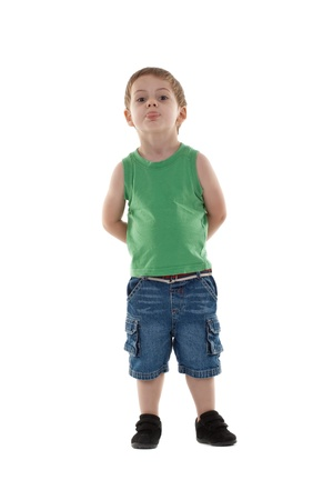 naughty child: Naughty child sticks out his tongue, isolated on white  Stock Photo