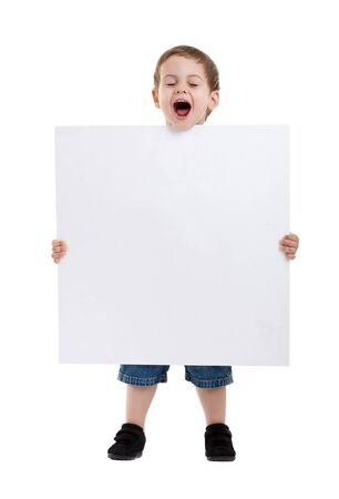 holding a sign: Portrait of a surprised little boy holding a billboard against white background