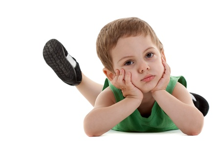 lonely boy: picture of a sad little boy lying on a white background