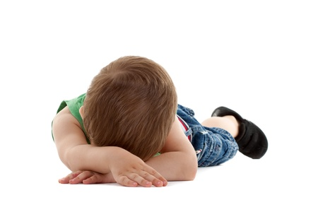 Little Child Lying in the floor and sleeping Stock Photo - 9370380