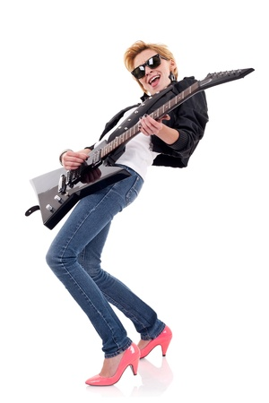 beautiful woman with sunglasses playing an electric guitar  photo