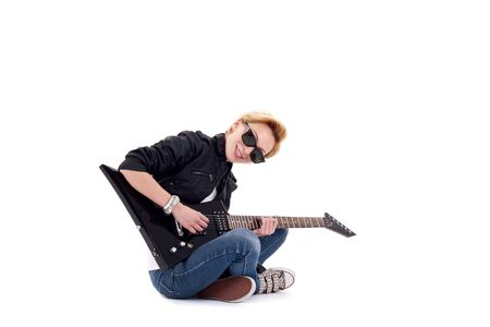 Punk Rockstar playing a guitar isolated in white Stock Photo - 9370266
