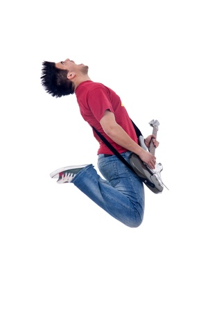 passionate guitarist jumps in the air and screaming photo