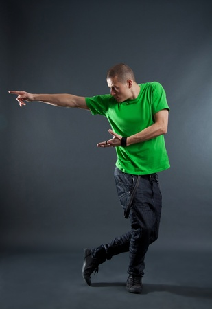stylish break dancer showing his skills on a white background  photo
