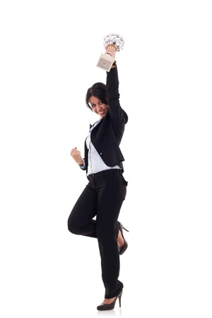 women holding cup: excited young business woman winning a trophy against white background