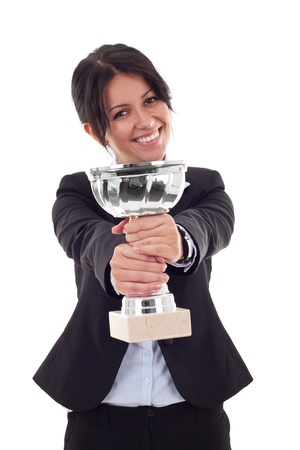 Portrait of a beautiful young woman winning a silver cup against white background  photo