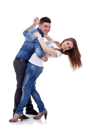 disco dancing: picture of a young couple dancing over white background