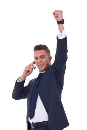 bandwagon: happy business man with mobile phone winning over white  Stock Photo