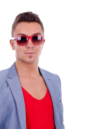 Portrait of a handsome young man in red sunglasses Stock Photo - 9526101