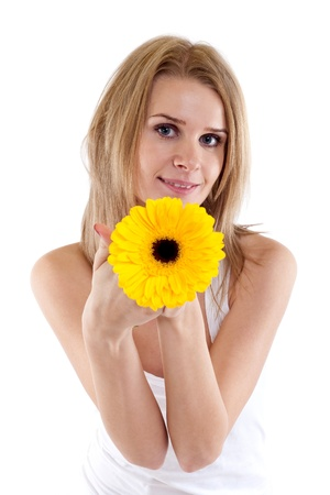 closeup of a pretty young woman holding a yellow flower photo