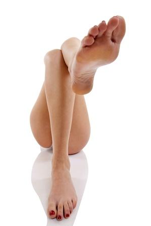 Woman leg on leg over white background  photo