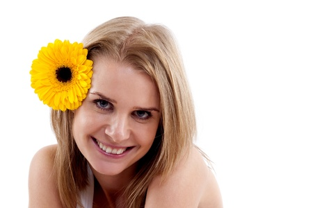 beautiful smiling woman portrait with flower on head, on white background  photo