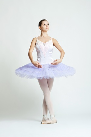 Professional ballet dancer isolated in studio , over white  photo