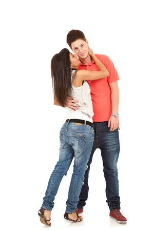 hot boy: Embracing glamorous couple standing on white background  Stock Photo