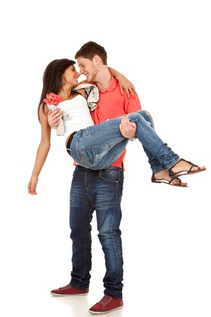 happy couple -  man  carrying girlfriend in his arms over white Stock Photo - 9730170