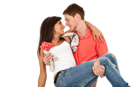 Happy  man romantically carrying wife in his arms over white Stock Photo - 9733724
