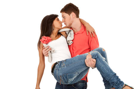 carrying girlfriend: happy couple -  man  carrying girlfriend in his arms and making happy faces Stock Photo