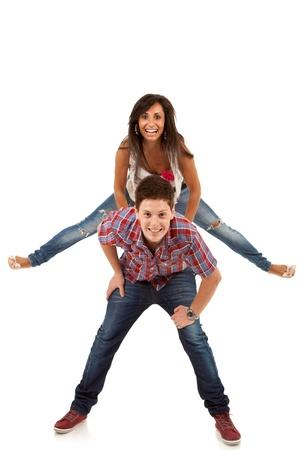 couple having fun - woman jumping on her boyfriends back photo
