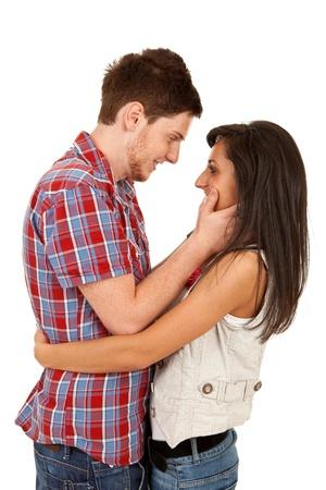 Sexy giovane coppia prima bacio isolata on white
