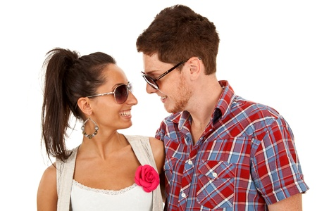 couple wearing sunglasses and standing face to face photo