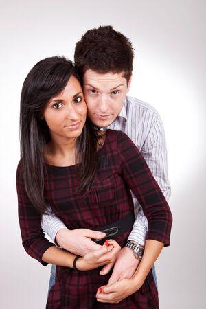 Embracing glamorous couple over grey back ground  photo