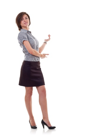 Business woman presenting something imaginary over white  photo