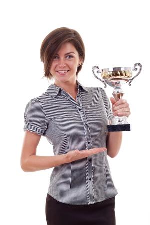 winning business woman: Portrait of an attractive young business woman winning a trophy against white background