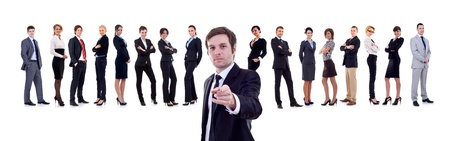 business man pointing with his team behind him photo