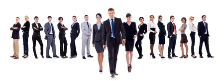 commands: Business leaders walking with their team behind isolated on white