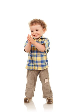 boy body: Full length of a cute boy smiling and looking a side Stock Photo