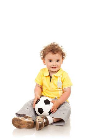Adorable boy holding a footbal ball, isolated photo