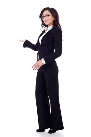 Business woman with her arm out in a welcoming or presenting gesture, isolated on white background  photo